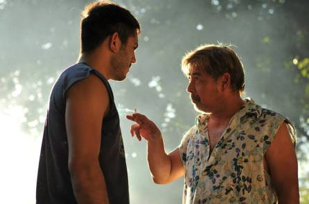 Mario teaching Daniel about being a contract killer. Image Source: Buy Bust Movie US Facebook Page